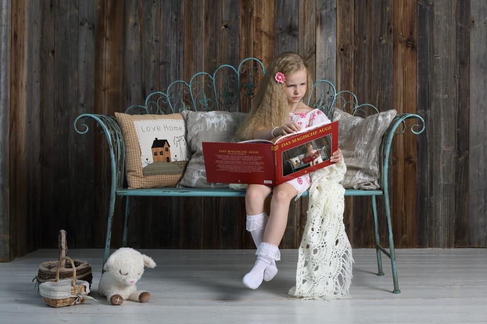 A piece of fine art art photography titled A Book About Me, Who Reads a Book a Bout Me, Who Reads by Victoria Ivanova