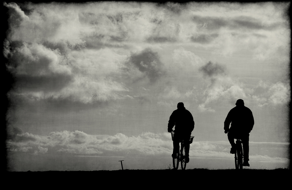 A piece of fine art art photography titled The Cyclists by Anja Buehrer