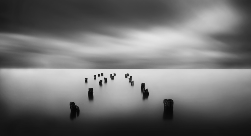 A piece of fine art art photography titled The Remains of a Pier by catalin alexandru