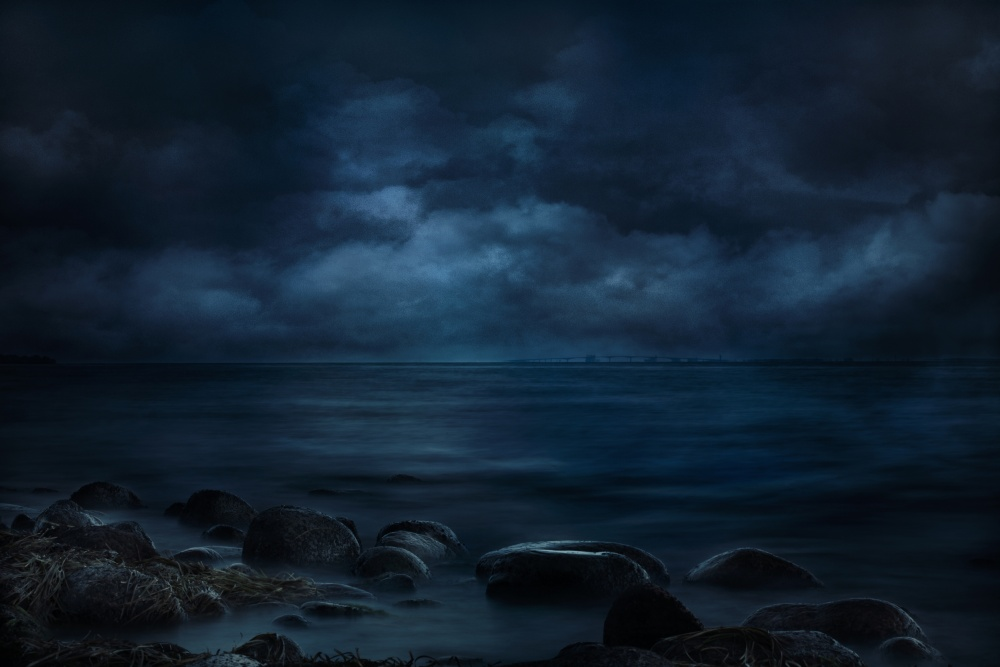 A piece of fine art art photography titled Moonlight Over Distant Shores by Willy Marthinussen