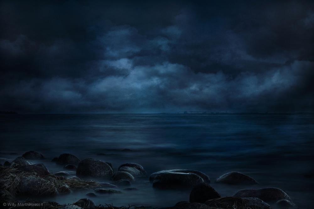 Moonlight over distant shores
