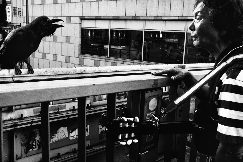 A piece of fine art art photography titled Talking by Tatsuo Suzuki