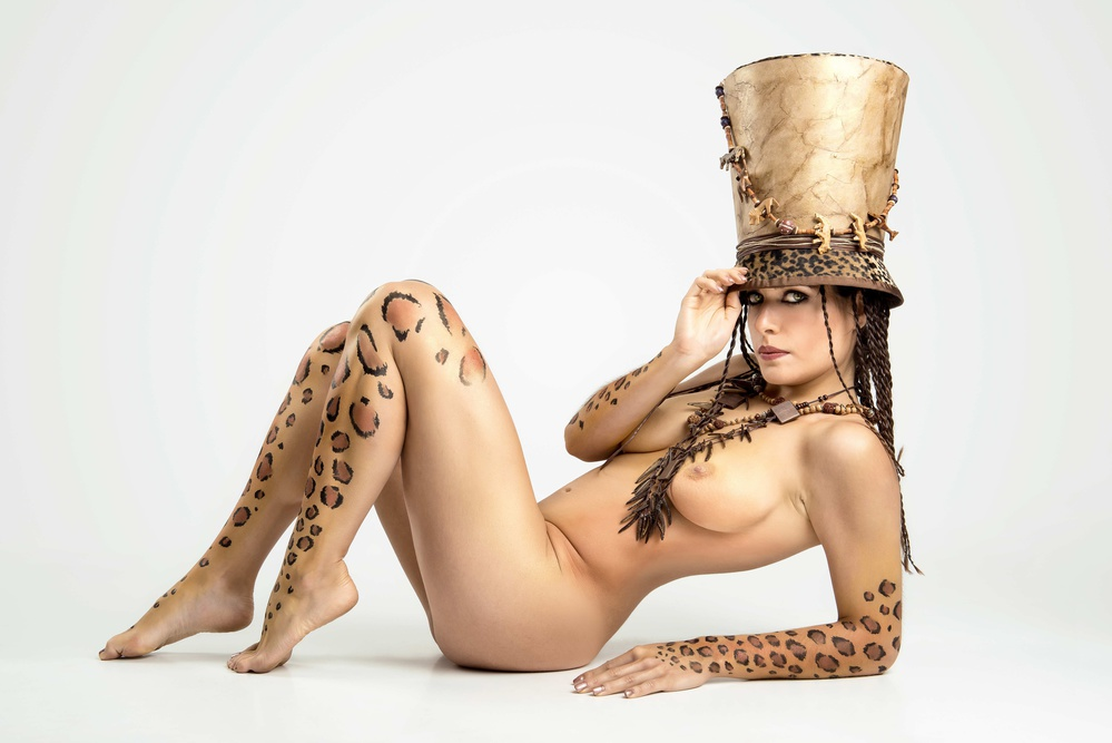 A piece of fine art art photography titled Leopard Girl IV by Luis Louro