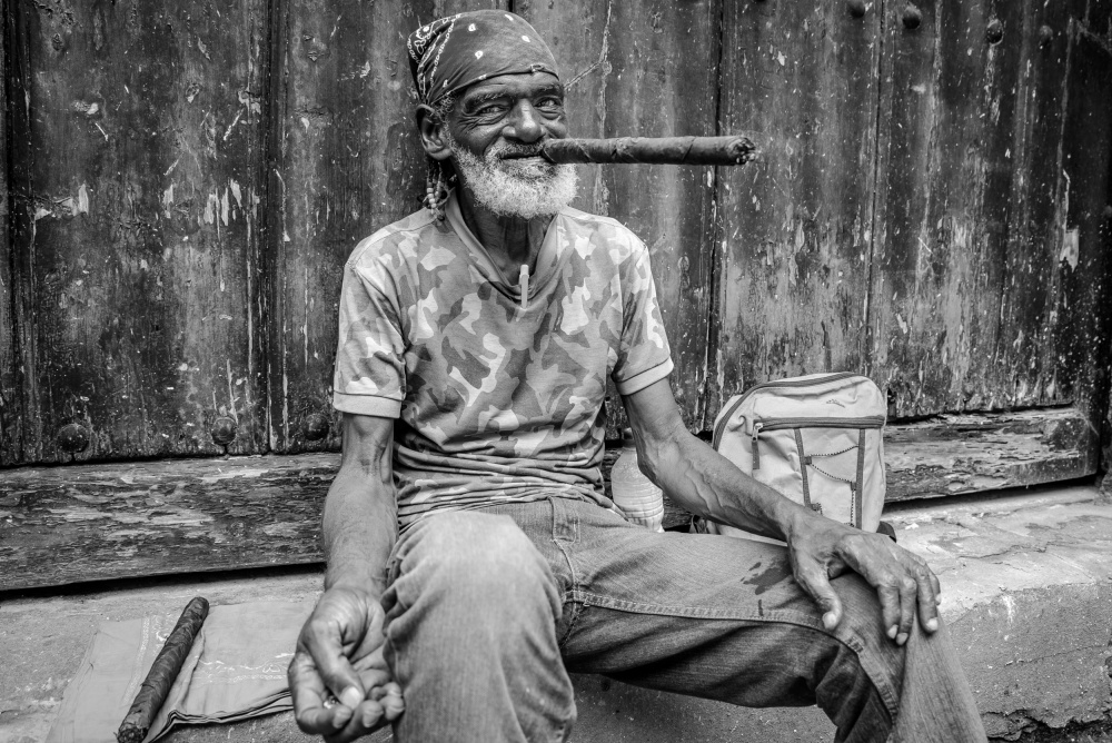 A piece of fine art art photography titled Smoke a Cigar by Marius Miclea