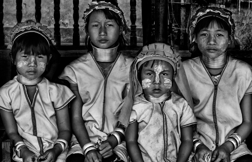 A piece of fine art art photography titled Four Padaung Girls (Myanmar) by Joxe Inazio Kuesta Garmendia