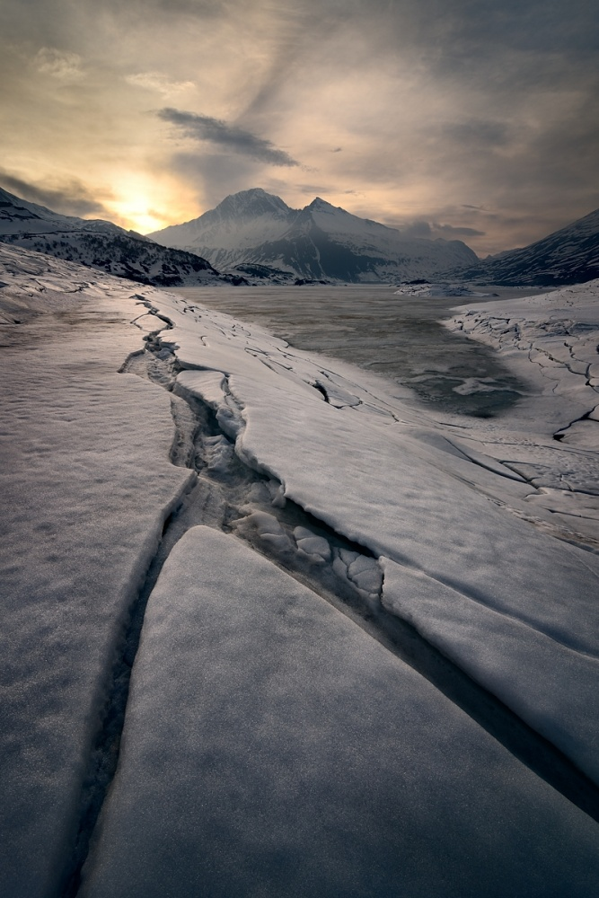 A piece of fine art art photography titled Sunset On Ice, Mont-Cenis Lake by Marco Barone