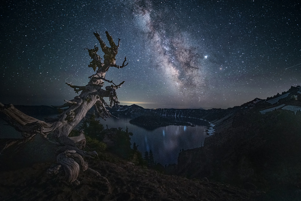A piece of fine art art photography titled Milky Way Over Crater Lake by Lydia Jacobs