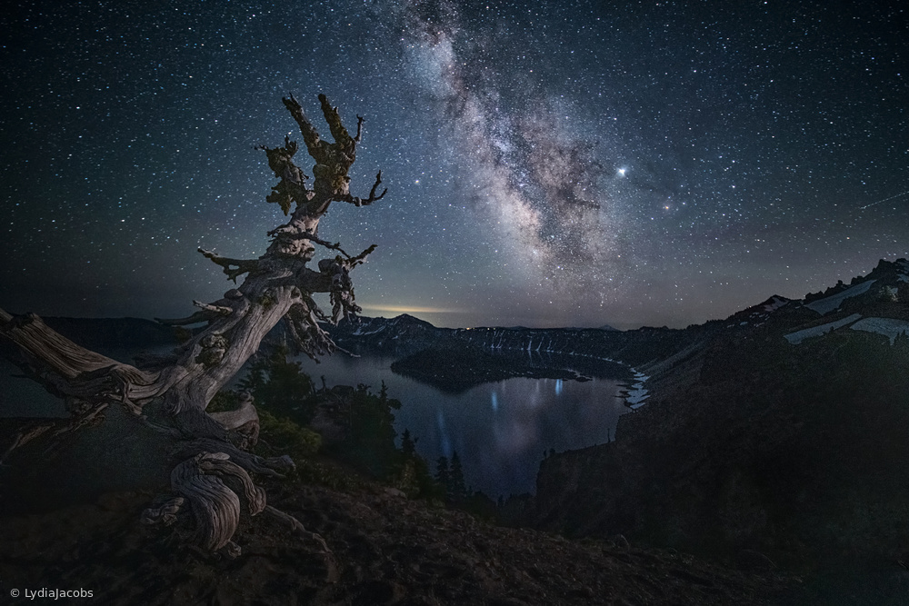 View this piece of fine art photography titled Milky Way over Crater Lake by Lydia Jacobs