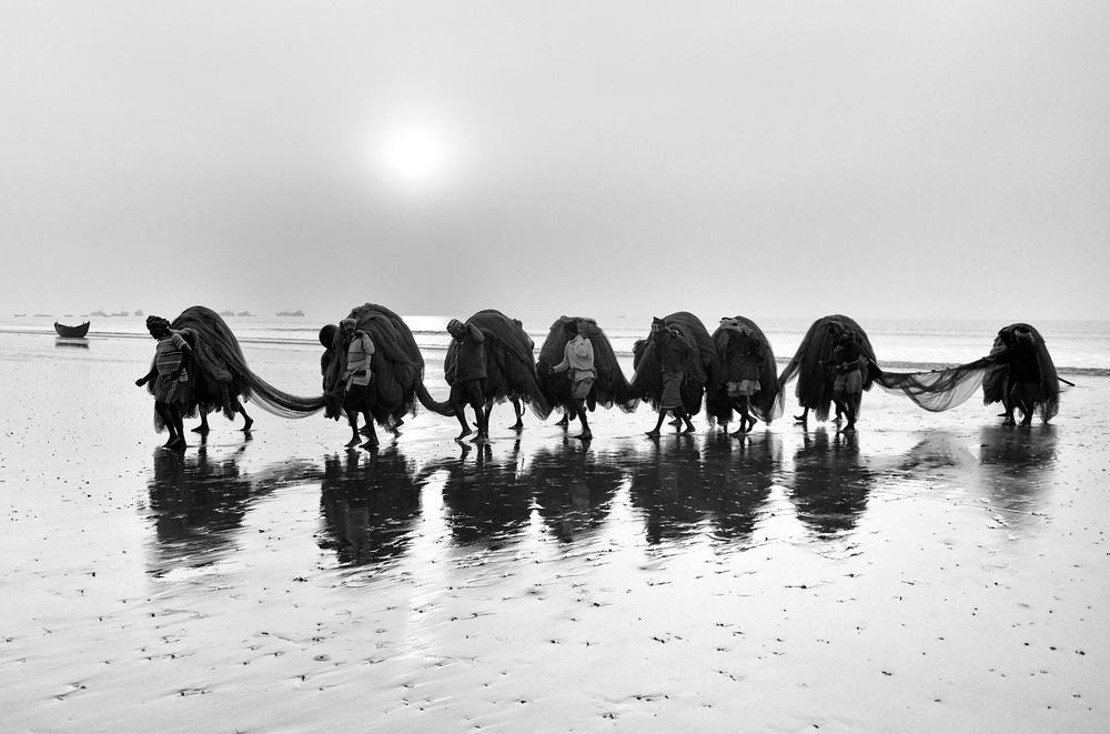 A piece of fine art art photography titled Fishing Work by Avishek Das