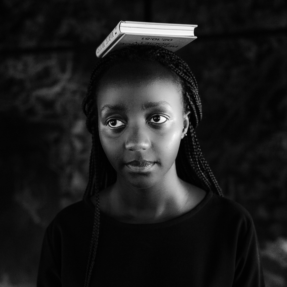 A piece of fine art art photography titled Girl With Book by Andreas Bauer