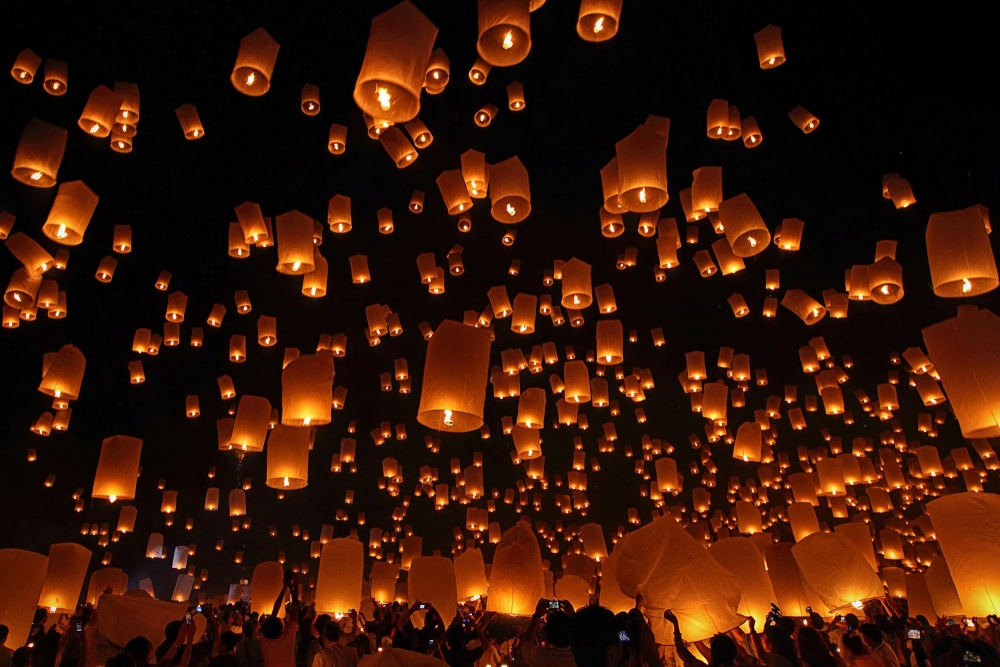 A piece of fine art art photography titled Floating Lanterns by Vichaya