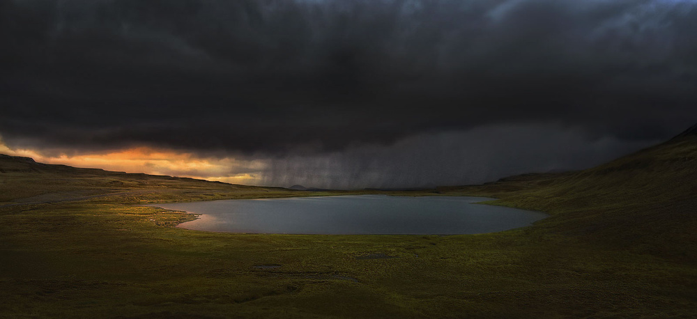 A piece of fine art art photography titled Storm Over the Lake by Amador Funes