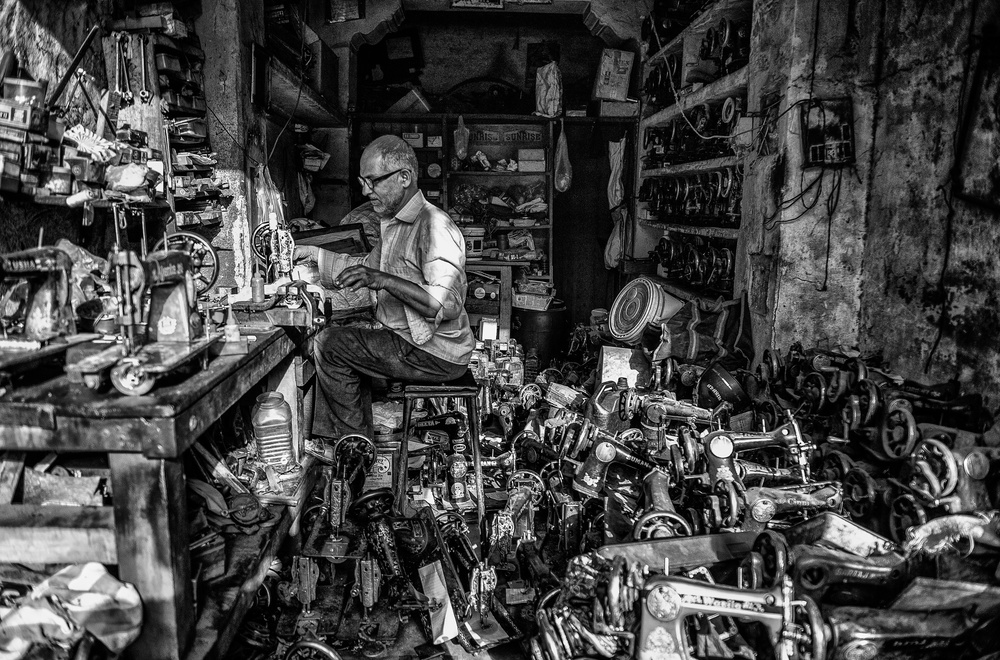 A piece of fine art art photography titled The Tailor and Sewing Machines by Andrei Nicolas - The Traveler