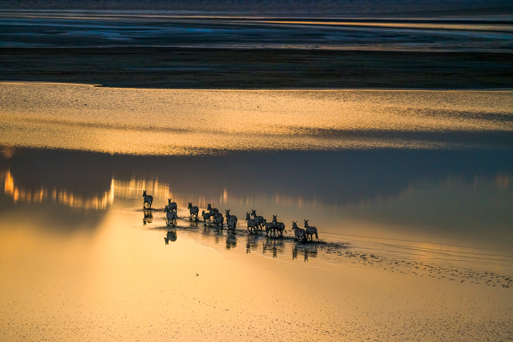A piece of fine art art photography titled Sunset Crossing by John Fan
