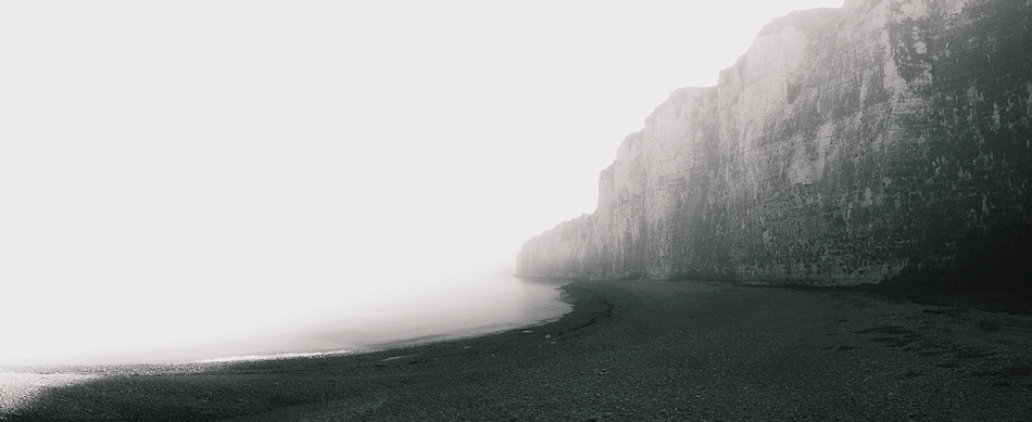 A piece of fine art art photography titled Cliffs In the Clouds by Yves Lambert