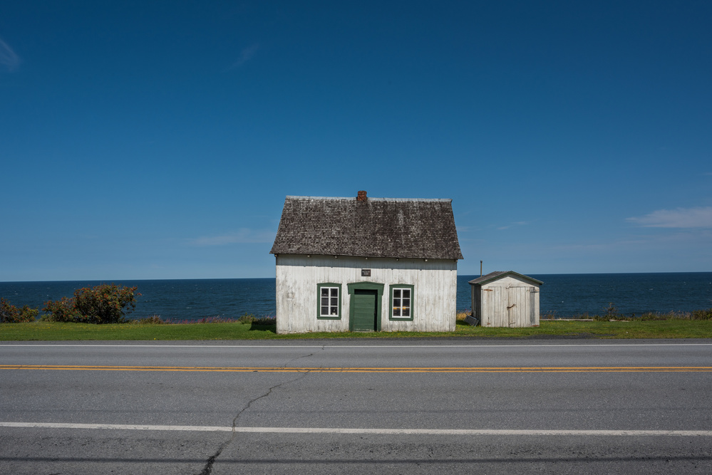 A piece of fine art art photography titled House On the Road 132 Gaspésie by Patrick Dessureault