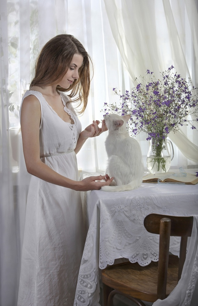 A piece of fine art art photography titled White Morning With White Cat by Svetlana Pavlоvskaja