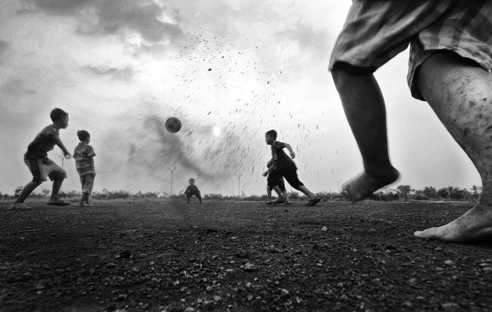 A piece of fine art art photography titled Playing Football by girdan nasution