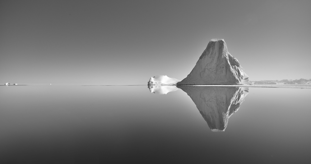 A piece of fine art art photography titled Total Reflections - Hurry Fjord - East Greenland by Fokion Zissiadis