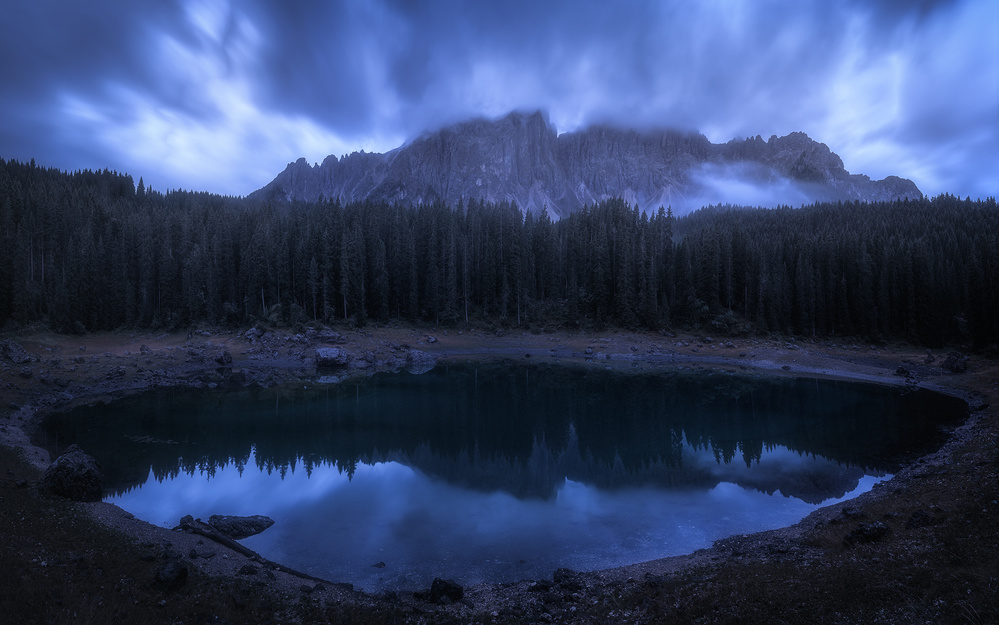 A piece of fine art art photography titled The Mysterious Lake by Daniel Fleischhacker