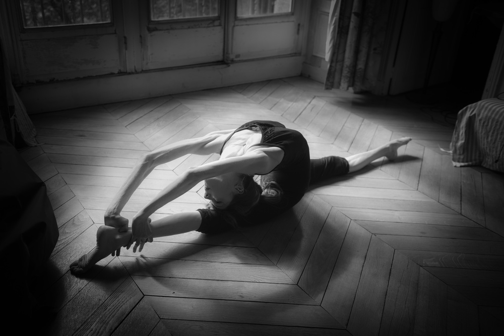 A piece of fine art art photography titled Contortion Training by Axel K. Schoeps