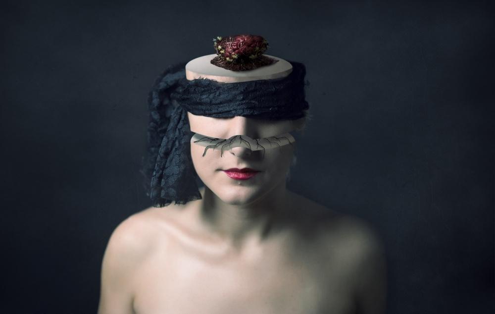 A piece of fine art art photography titled El Corazón Sobre El Cerebro by claudia méndez cordero