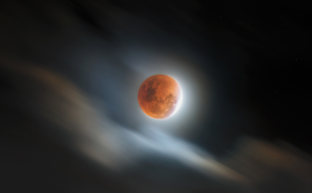 A piece of fine art art photography titled Super Blood Lunar Eclipse by rooswandy juniawan