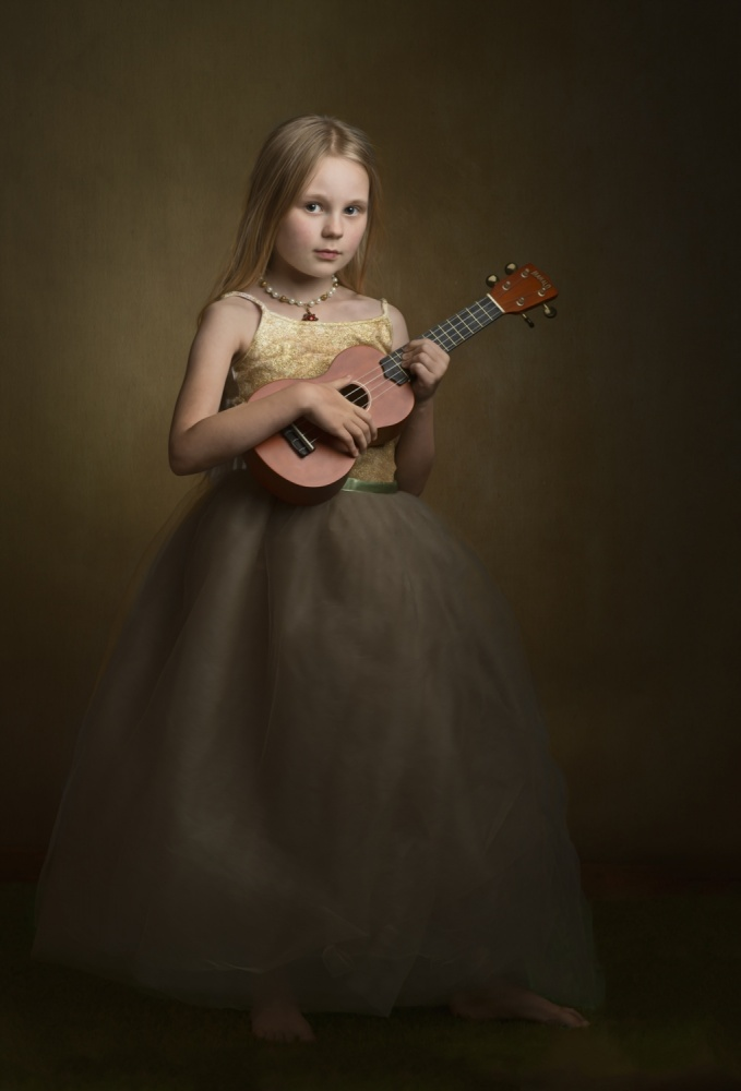 A piece of fine art art photography titled The Girl With the Ukelele by Nicole Wells