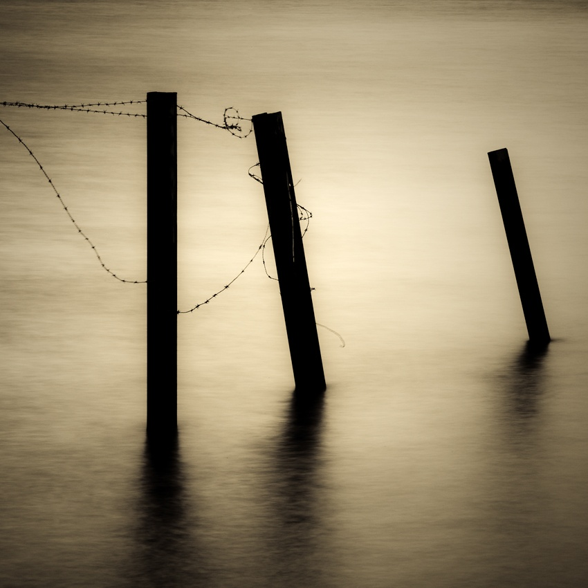 A piece of fine art art photography titled Fences by John-Tore Gundersen