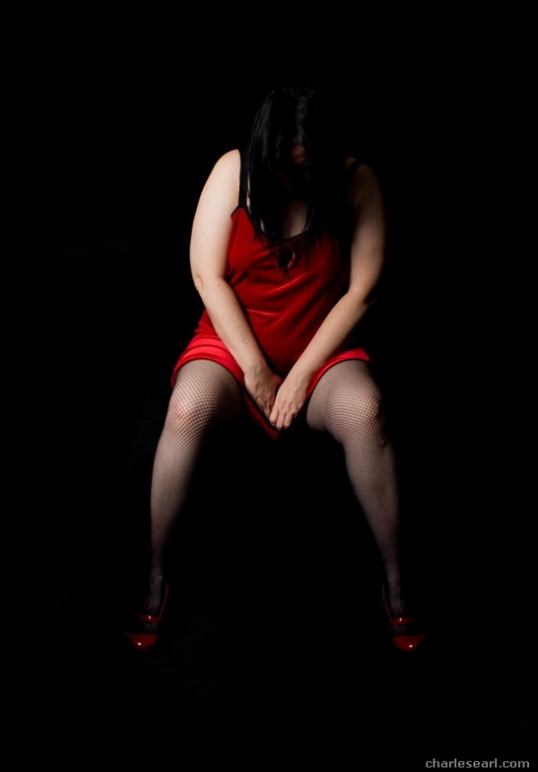 A piece of fine art art photography titled Red Dress by Charles Earl