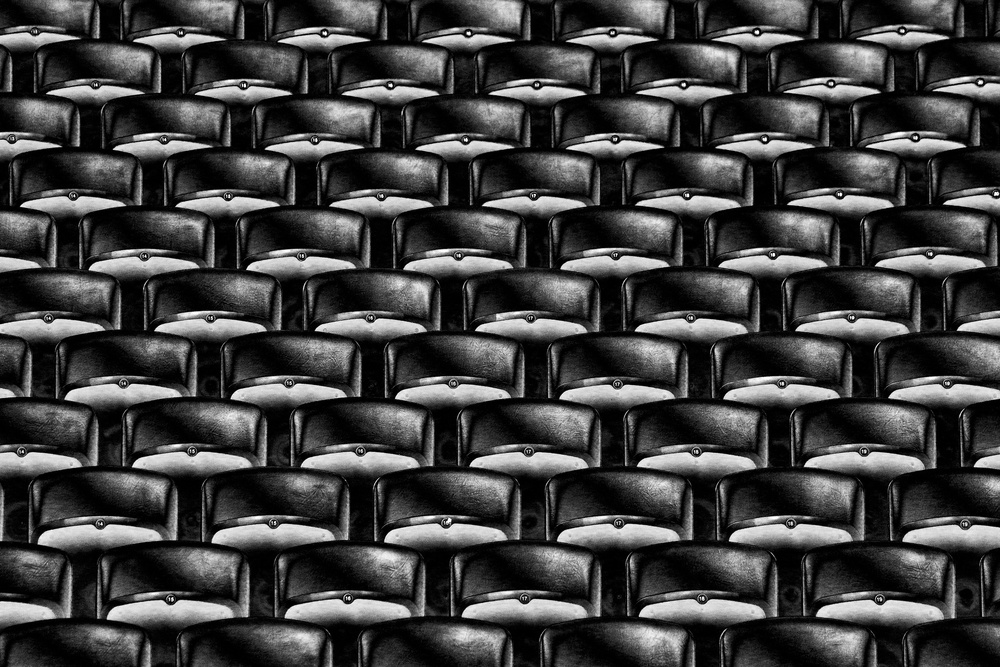 A piece of fine art art photography titled Take Your Seats Please! by Hans-Wolfgang Hawerkamp