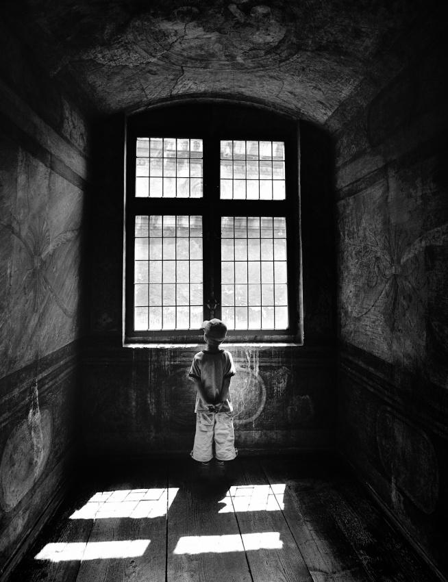 A piece of fine art art photography titled Boy In a Pensive Mood by Przemek Wielicki