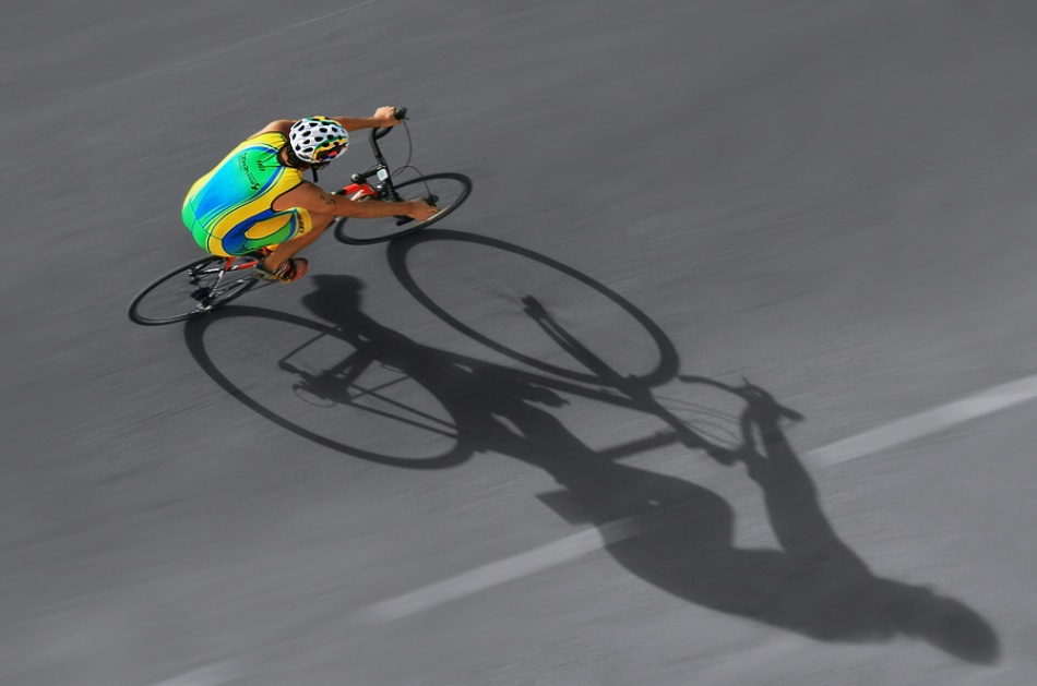 A piece of fine art art photography titled Cyclists and Their Shadow by Juan Luis Duran