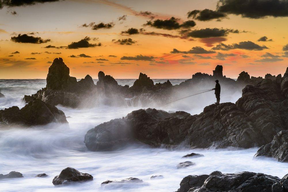 A piece of fine art art photography titled The Sunset Fisherman by MERİÇ AKTAR