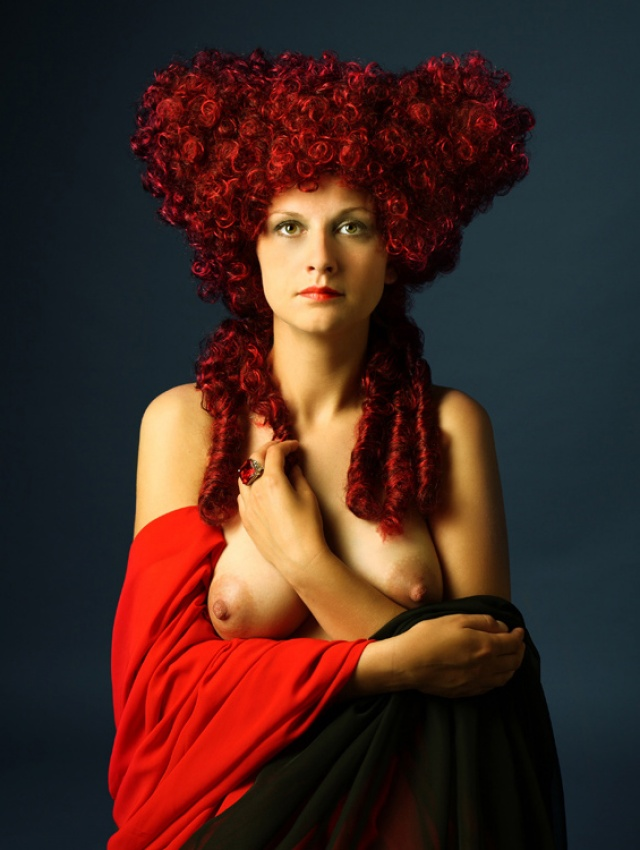 A piece of fine art art photography titled Portrait of a Young Woman With a Red Ring by Ramunas Blavasciunas