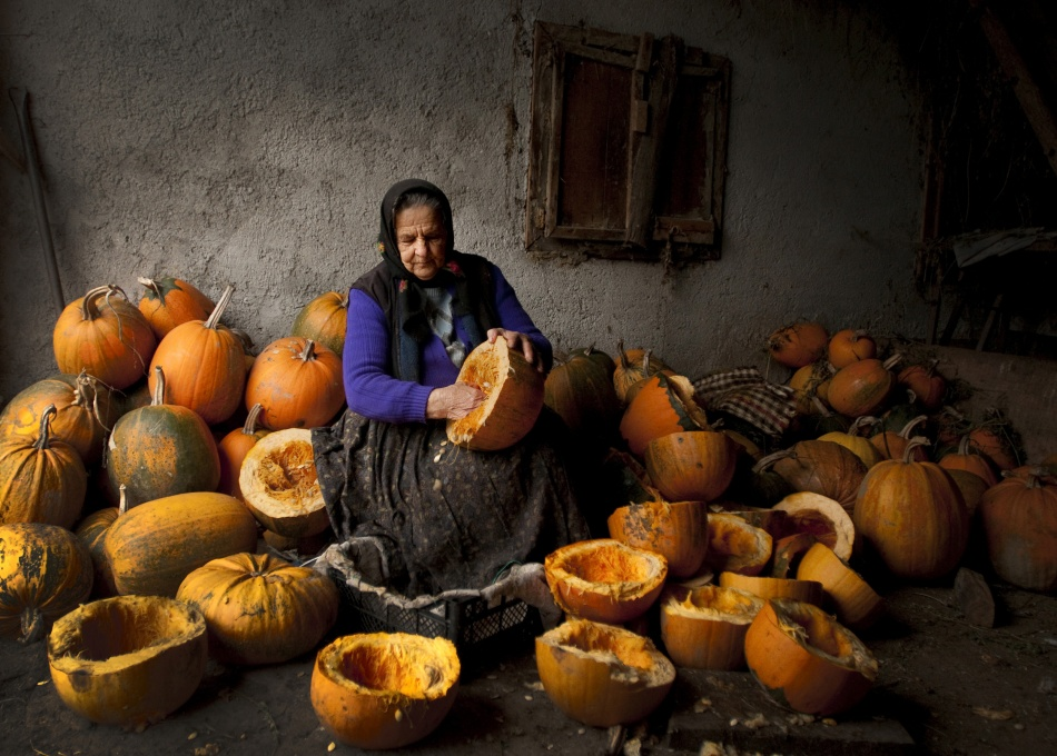 A piece of fine art art photography titled Lady With Pumpkins by Mihnea Turcu