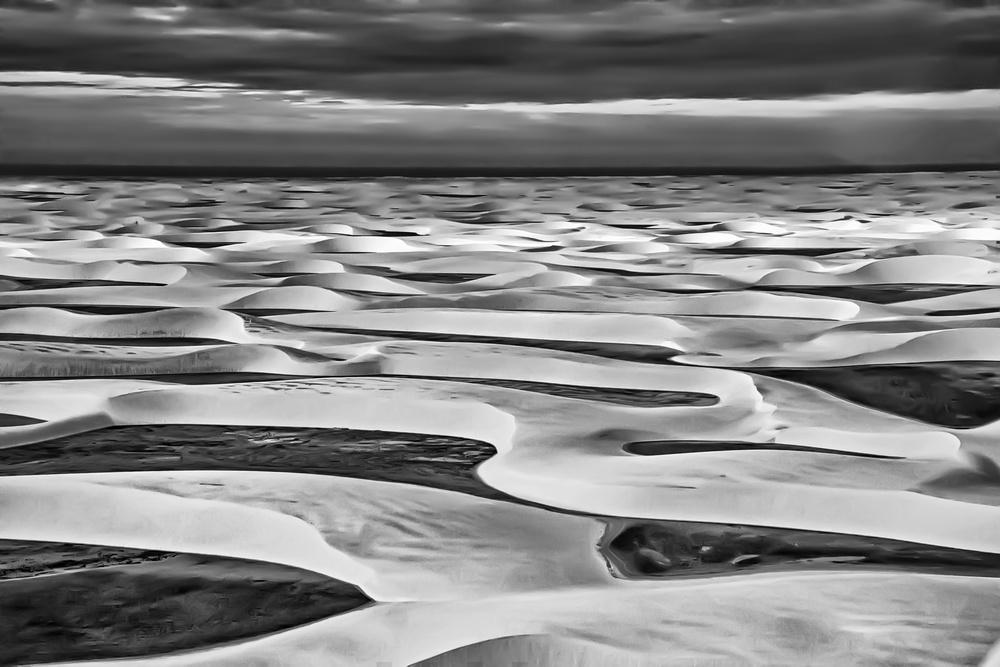 A piece of fine art art photography titled White Sand Dunes of Lençóis Maranhenses Desert by Daniel Schwabe