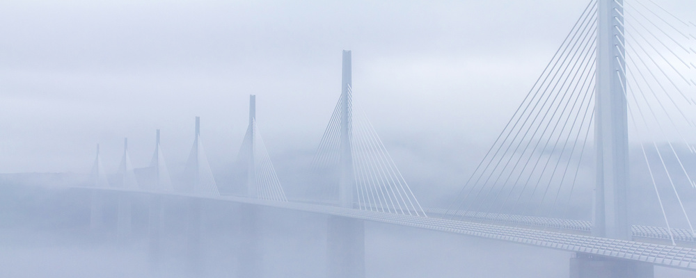 The fog dissipates on the viaduct of Millau - France