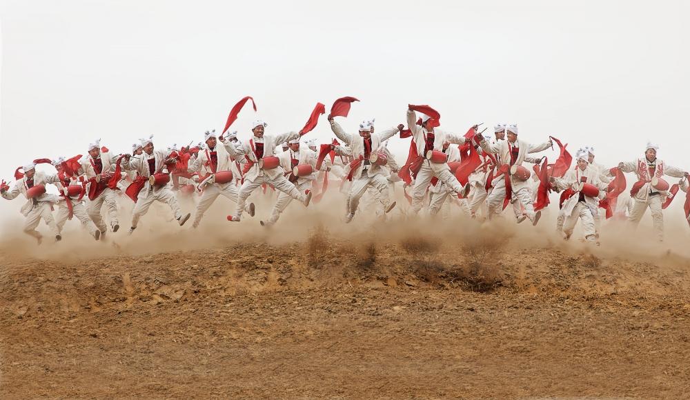 A piece of fine art art photography titled The Ansai Waist Drum Dance by BJ Yang