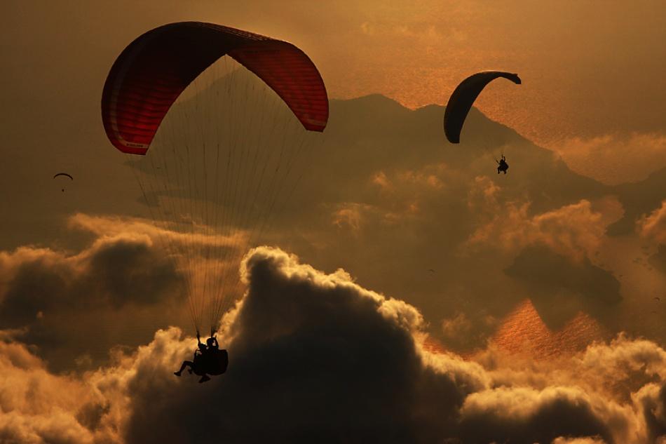 A piece of fine art art photography titled Paragliding by Yavuz Sariyildiz